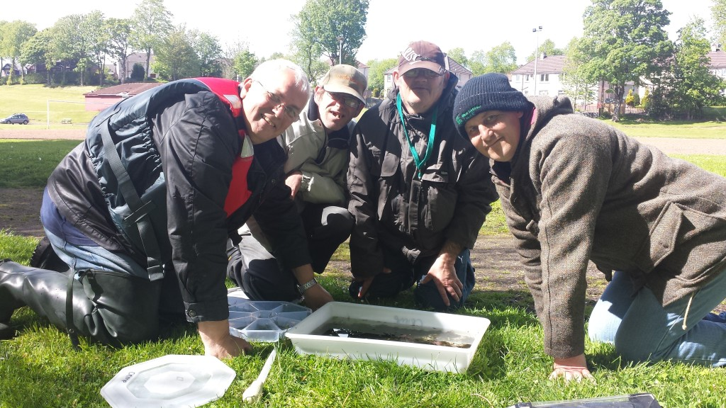 Keen anglers from Quarriers learning more about riverflies for the Clyde Riverfly Monitoring Partnership. The group is now actively involved in monitoring the health of the Tollcross Burn.